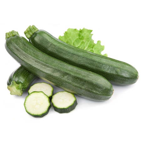 zucchini courgette decorated with green leaf lettuce. Isolated on white Stock Photo
