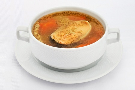 Fish soup a white plate white photo