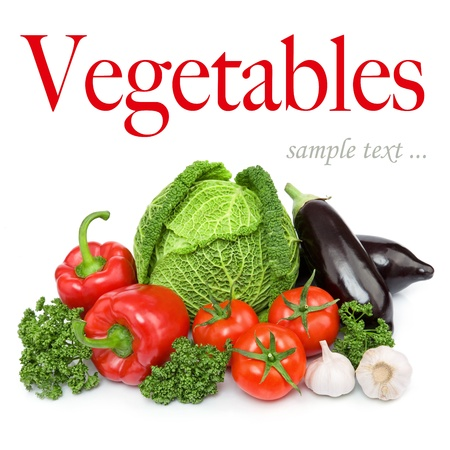 Composition with variety of fresh organic vegetables. Isolated over white background photo