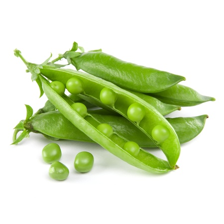 peas in a pod: fresh peas isolated on white background