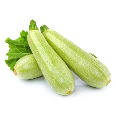 vegetable marrow: Fresh vegetable marrow decorated with green leaf lettuce. Isolated on white