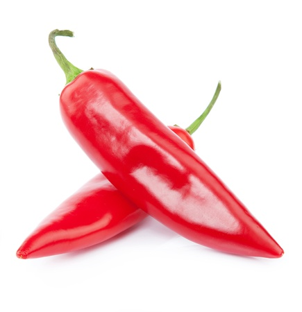 Two red chili peppers isolated on the white photo
