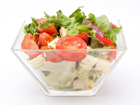 Tossed green salad, with cherry tomatoes, fetta cheese, red onion, cucumber, yellow bell pepper, and mixed greens. A healthy meal. photo