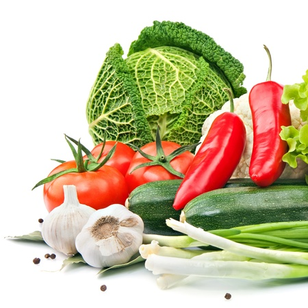 Raw vegetables on the white background