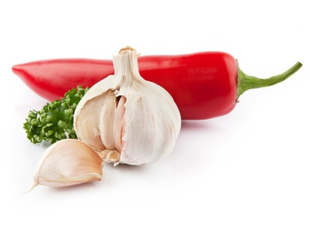 garlic & red pepper decorated parsley leaves isolated on white background photo