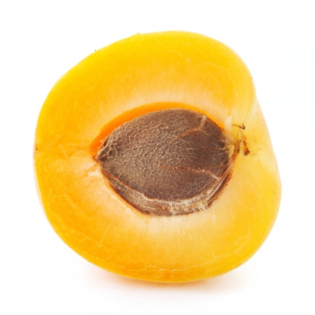 Apricot halves fruits isolated on white background photo