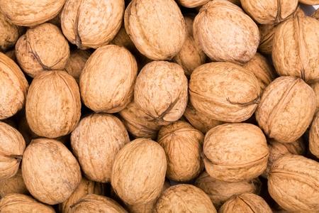 Brown walnuts textured background photo