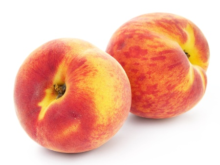 the peach: two peach fruits isolated on white background  Stock Photo