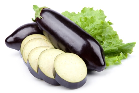 violaceous: aubergine vegetable decorated with lettuce leaves isolated on white