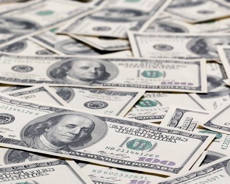 cash money: Cien dólares de pila como fondo. Foto de archivo