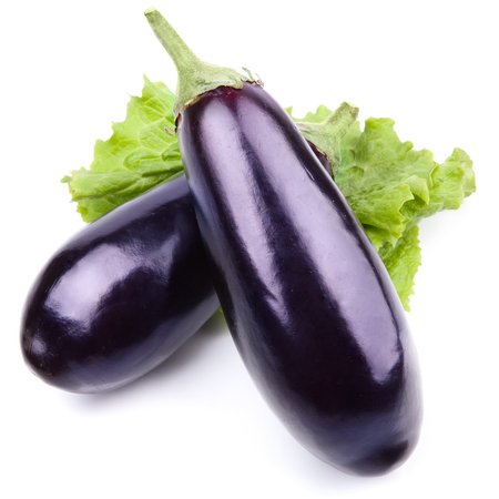 violaceous: aubergine vegetable decorated with lettuce leaves isolated on white   Stock Photo