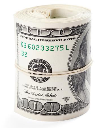 cash money: Billetes de cien dólares enrollados con goma elástica. Foto de archivo