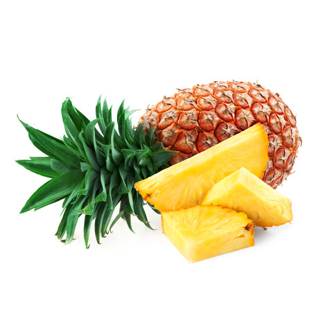 pineapple with slices isolated on white   photo
