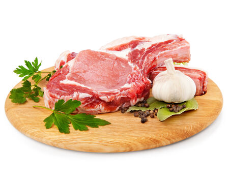 butchered: meat pork on cutting board in closeup over white. Clipping Path