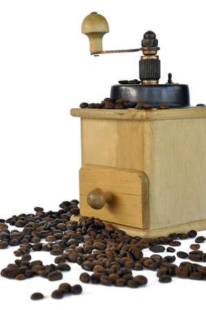 coffee grinder and coffee beans on the white background