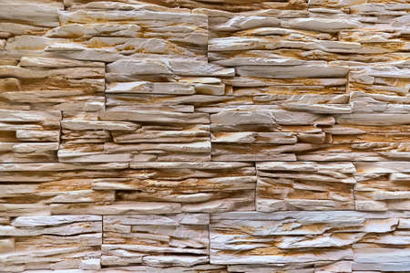 The wall of horizontal long light decorative stone as background Stock Photo