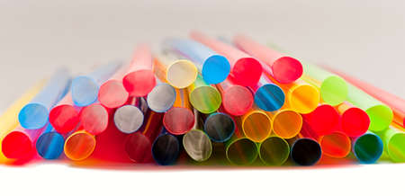 Many colorful  straws on the white background