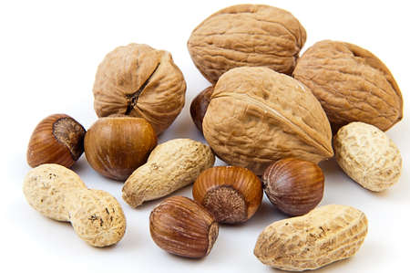 Walnuts, earth nuts and others on the white background