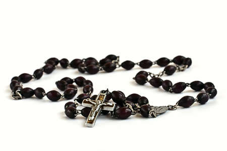 Black half wooden half metal rosary on the white background