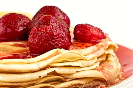 pancakes with strawberry jam on them Stock Photo