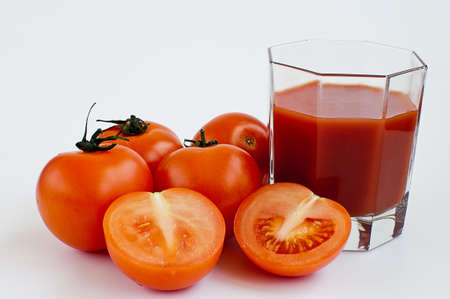 tomatoes and tomato juice on the white background