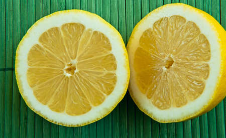 Fresh lemon on the green background