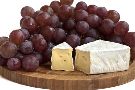 Camembert cheese with grapes Stock Photo