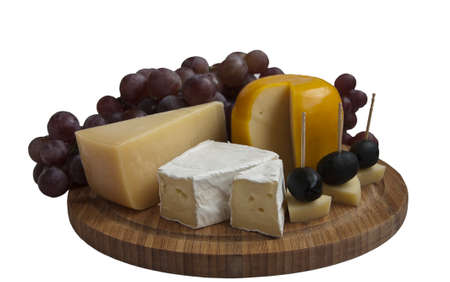 cheese, grapes and olives on a white background Stock Photo