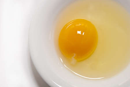 raw egg on a white plate