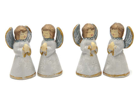 four angels on a white background Stock Photo