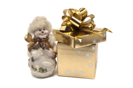 Snowman and golden gift box Stock Photo