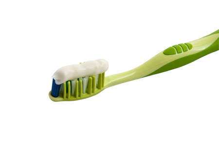 toothbrush with toothpaste on a white background