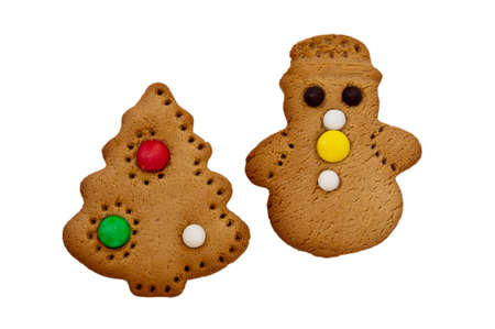 Gingerbread and Christmas tree on a white background   photo