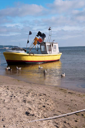 One fishing boat on the shore of the Baltic Sea