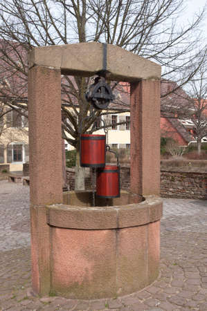 ancient well with buckets in Ladenburg