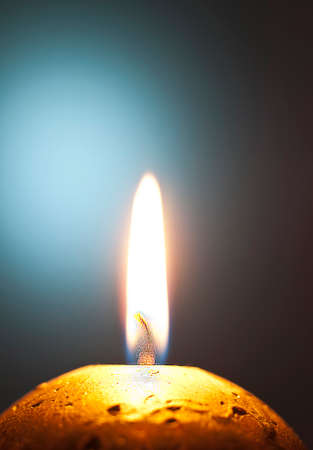 warmness: Macro flame of the candle in the darkness Stock Photo