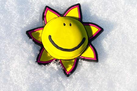 Toy sun on the snow Stock Photo