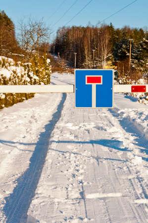 sign of deadlock on winter road