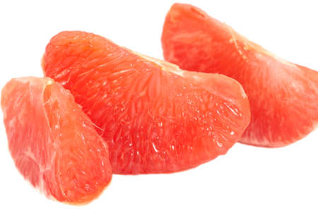 red grapefruit on a white background