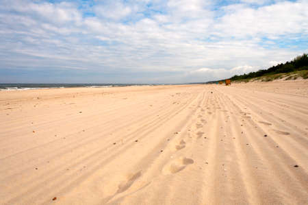 Footprints in the sand of the Baltic Sea beach
