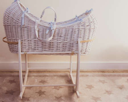 Moses basket - cot made of cane for a baby.
