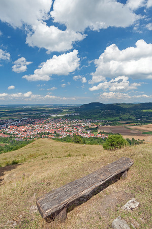 Bench on hill with view down in the Swabian Highlands, Southern Germany