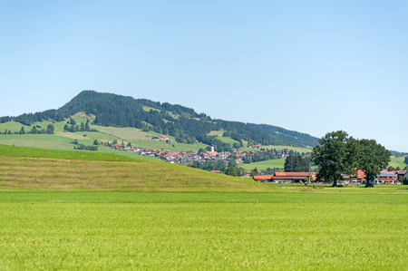 Village in front of hill in Allgaeu, Southern Germany