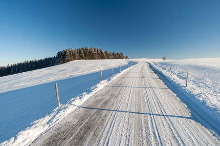 Country road in deep winter in the region of Allg?u, Germany