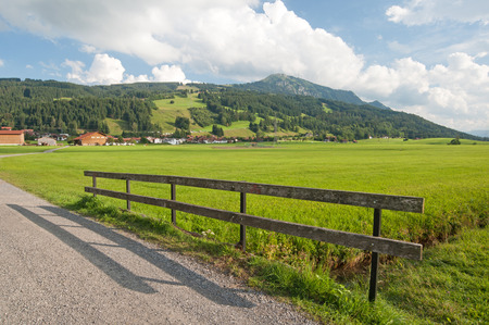Landscape with driveway and fence in Southern Germany 写真素材