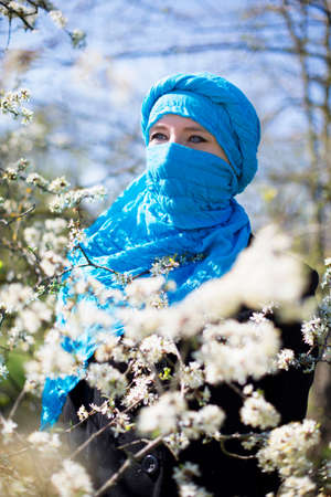 niqab: Beautiful woman in a Niqab in spring Park. Focus on the eyes.