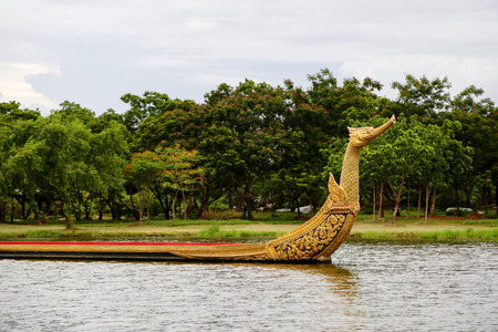 watercourse: BANGKOK, THAILAND Ancient Siam Ancient City, Mueang Boran park, Royal Water-Course Procession, decorated wooden thai boat on pond. Stock Photo