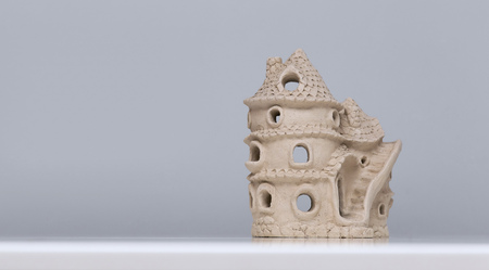 misterious: Doll house made of clay. Ceramic fairy tale toy.