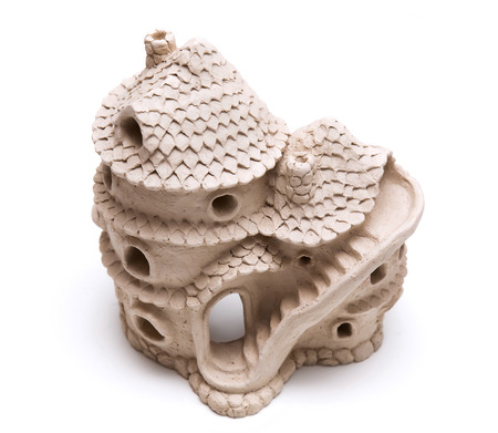Doll house made of clay. Ceramic fairy tale toy.