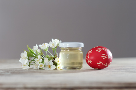 Painted easter eggs composition with spring honey and cherry flower Reklamní fotografie